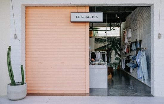 small-clothing-store-with-pale-pink-door-and-open-storefront