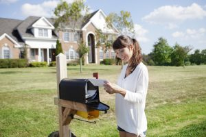 woman checking mail box